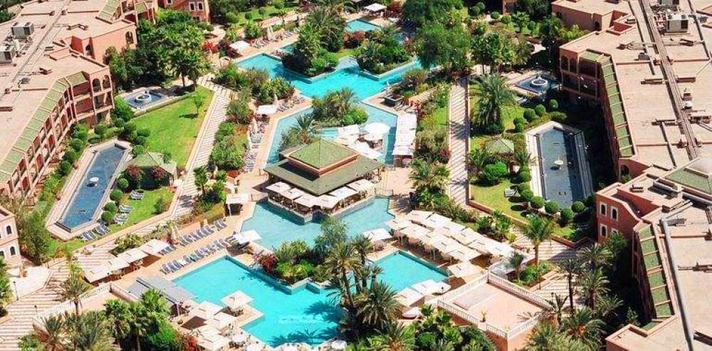 Les jardins et les piscines vus depuis les chambres du PalmGolf Resorts Marrakech
